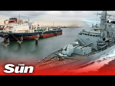 Royal Navy trains guns at Iranian boats trying to storm British tanker