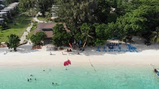 Islander's Bar, pan out over Pattaya Beach. Dusk.