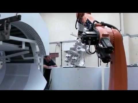 Opticast (UK) Ltd- Investment Casting Shelling System using KUKA Robot