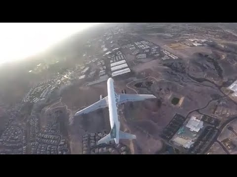 FAA investigating after footage emerged of drone flying above aircraft on approach to Las Vegas