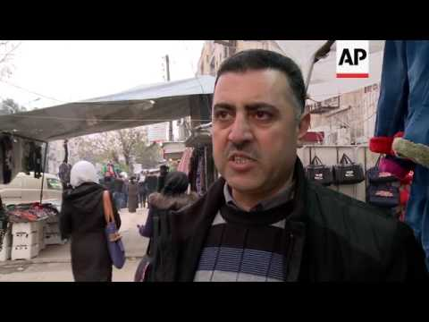Residents in western Aleppo comment on conflict