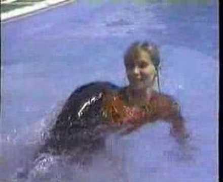 Girl swam fully dressed.