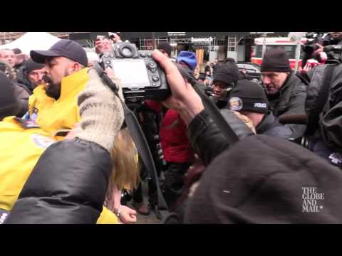 Protester tackled at courthouse following Ghomeshi verdict