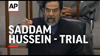 Saddam, co-defendants forced to attend latest session of trial
