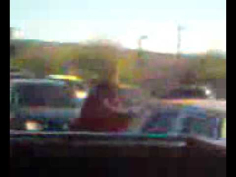 Bum randomly cleaning car windshields