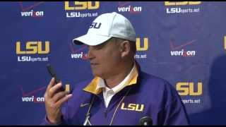 Les miles answers reporter's phone during presser