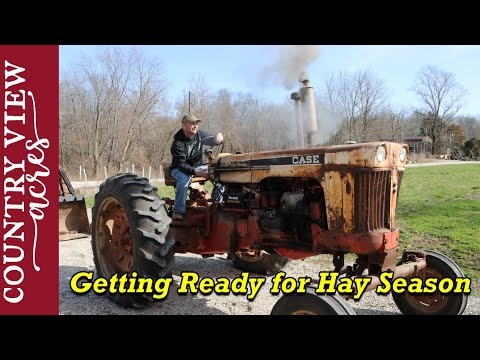 Changing oil in 1961 Case 730 tractor  |  First use of Lube Shuttle Grease gun.