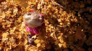 Slow motion fall leaves with my pretty little girl