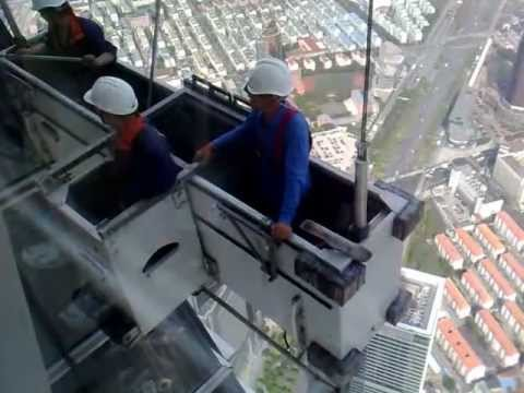 Window cleaners on top of Shanghai World Finance Center
