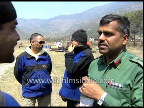 Porters carry loads into helicopter for trekkers - Everest expedition