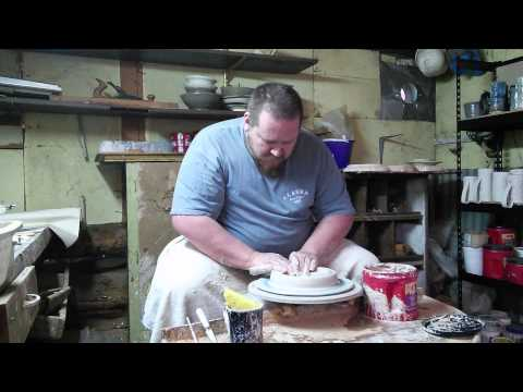 Making a ceramic plate on the potters wheel.