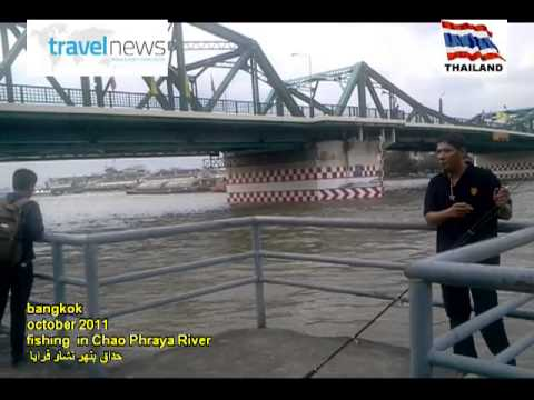 fishing in chao phraya river in bangkok