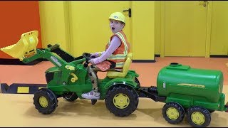 Sofia Plays in the city of Professions for Kids, rides a Tractor and Excavator.