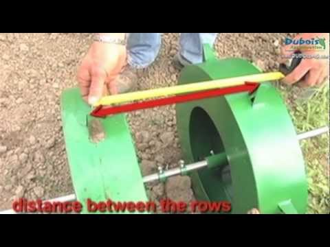Transplanter with water wheel on mulch film with Rain-Flo 1600 | Dubois Agrinovation