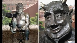Spanish city protests over new sculpture of Satan smiling - Daily News