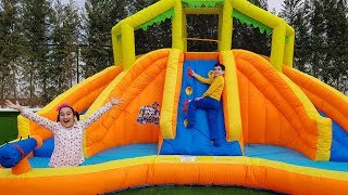 Kids pretend play with Inflatable water slide and easter egg