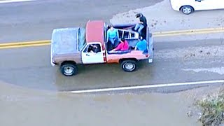 INSANE DUDE NAVIGATES COLORADO FLOOD WATERS IN PICKUP TRUCK