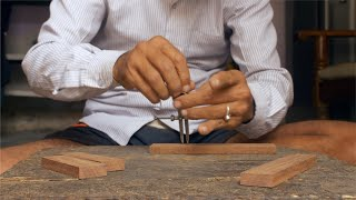 Tarkashi - Craftsman drawing designs with the compass on the wooden piece