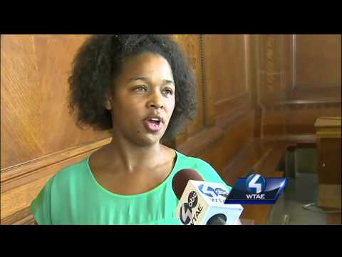 Group demands change during rally at City-County Building