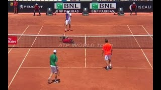 Tennis player takes partner out with a brutal serve to the head