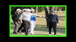 Breaking News | On the golf course, japan's abe did a backward roll — and trump didn't even notice