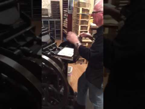 Vintage Printing Press (1909) in Pennsylvania USA-Printing a coaster