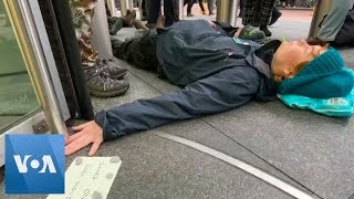 Climate Activists Glue Themselves to Barclays Building in London