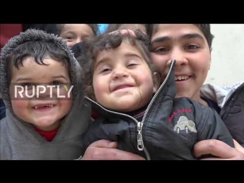 Syria: Russian servicemen deliver humanitarian aid at Jibreen refugee camp