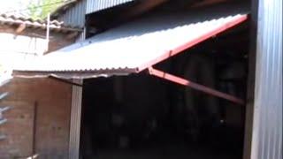 як зробити орні ворота в гараж своїми руками