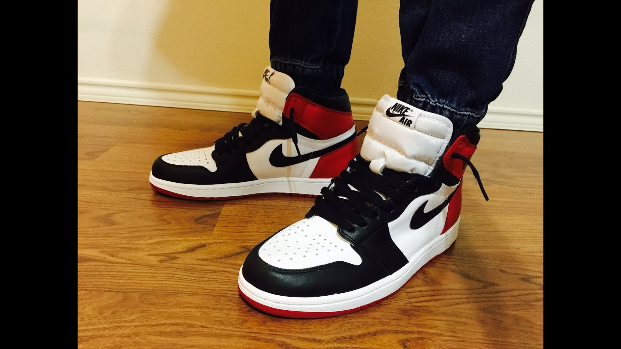 a4143eb6381 Air Jordan Retro 1 OG Black Toe unbox review showing different outfits on  feet