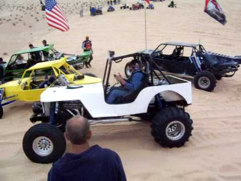 Buggy jeep jumps sand dune at Patton Valley, Imperial Sand Dunes
