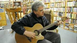 "Enrico Renz sings his song ...""Spare What You Can""  at the Renaissance Books store."