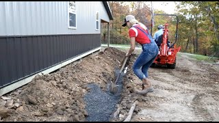 #933 Digging and Installing Drain Lines, and Good News From the Power Company!