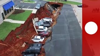 Drone footage: Giant sinkhole swallows 14  cars in Mississippi parking lot