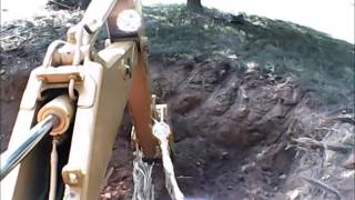 Digging hole for tree using 1987 JOHN DEERE 210C backhoe loader