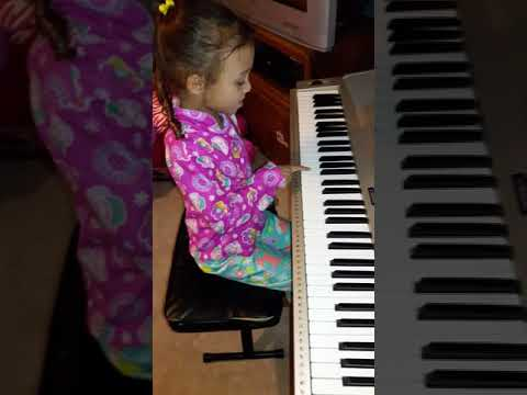 Lexi playing the notes abcde