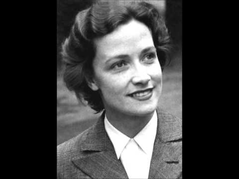 Kathleen Ferrier singing a medley while playing the piano.