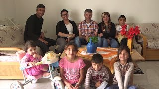 Greek locals welcome refugee families