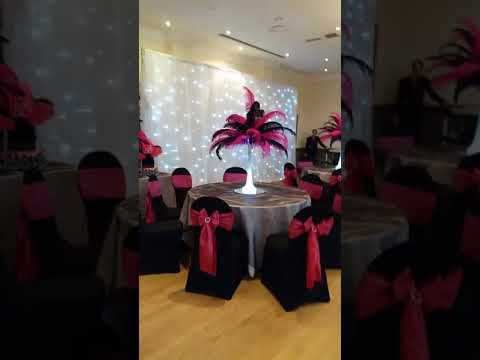 Black and pink ostrich feather centerpieces and chair covers