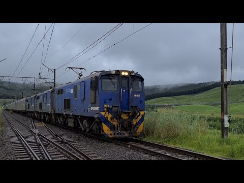 Spoornet class 18E locomotives just outside Balgowan station heading towards Durban.
