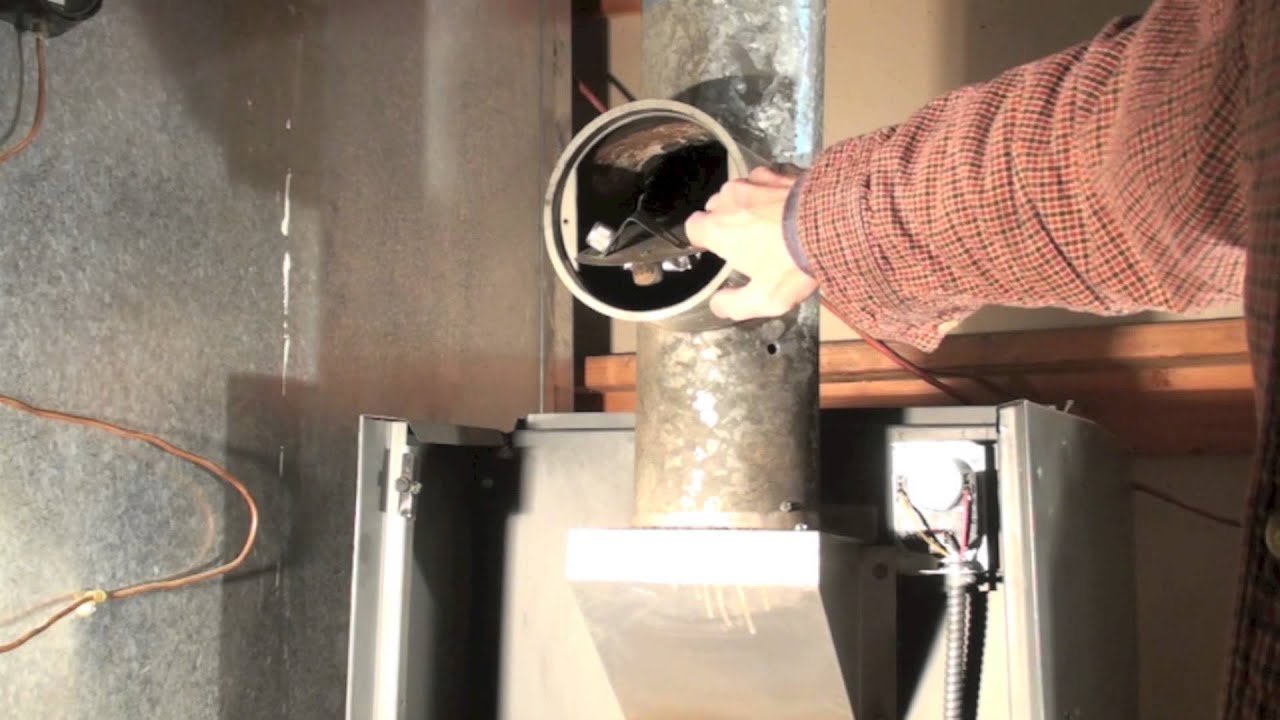Should you plug the sensing hole in the oil furnace vent?