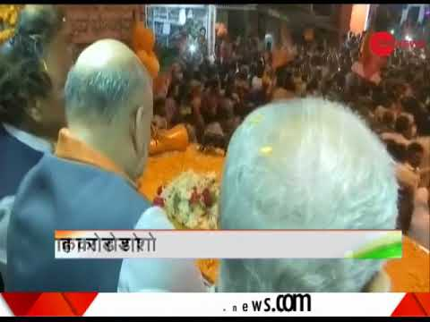 Deshhit: BJP President Amit Shah holds a roadshow in Shimoga, Karnataka