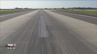 Employees blast rubber from Tampa Airport runways