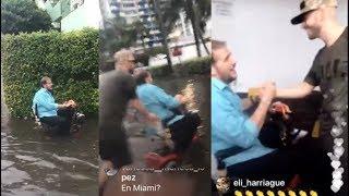 Yandel ayuda a un hombre discapacitado que se habia quedado atrapado en una inundación