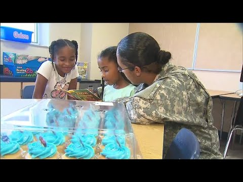 Mother returning home from active duty surprises daughters at school