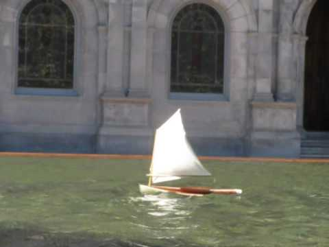Mellonseed skiff RC model sailing in strong wind on Boston Reflecting pool