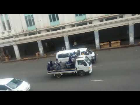 Riot police firing shots at demonstrators in Harare