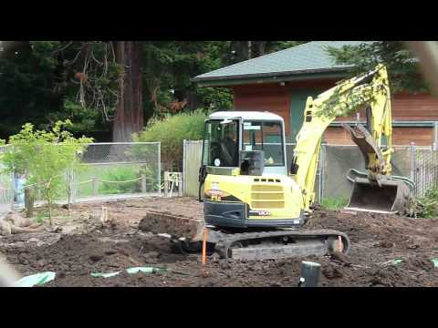 Yanmar mini excavator digging and moving dirt at Sequoia Park Zoo