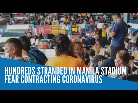 Hundreds stranded in Manila stadium fear contracting coronavirus