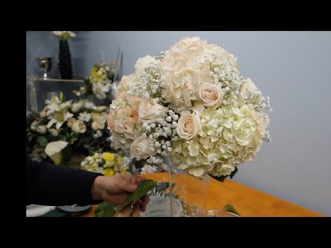 how-to-make-a-tall-vase-centerpiece-with-white-hydrangea-and-roses